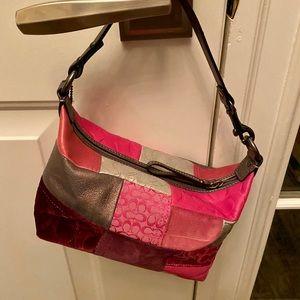 Pink multi pattern coach purse